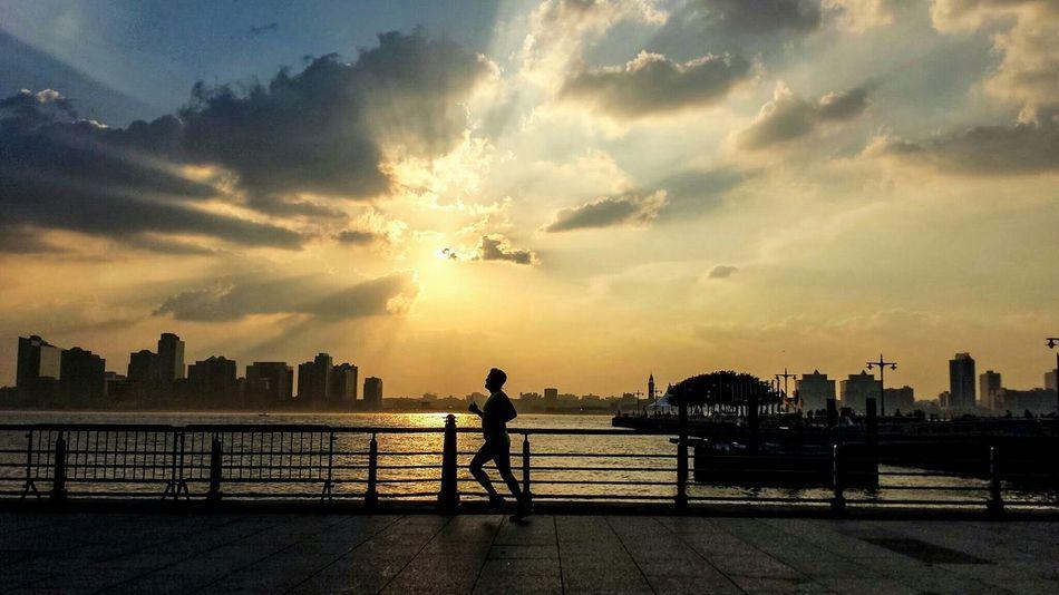 Sunset Man Jogging along Hudson Park. Protecting Where We Play