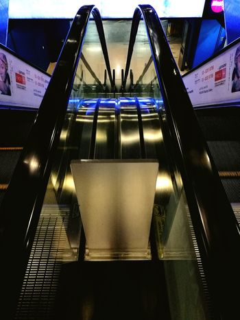 Indoors  Built Structure Illuminated No People Architecture Escalator Escalators Step Steps Downward View Blue Illumination Mall Stunning Striking View Striking Indoors  Illusion Cross Eyed