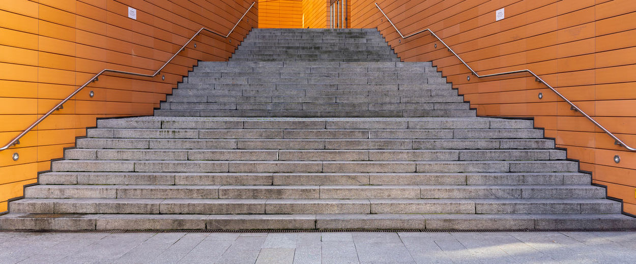 Staircase Architecture Steps And Staircases The Way Forward Low Angle View Direction Built Structure No People Railing Pattern Wall - Building Feature Indoors  Moving Up Empty Absence Diminishing Perspective Day Orange Color Building