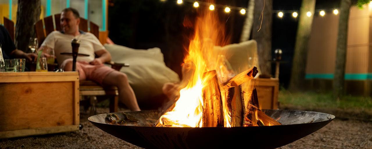 Man burning fire at night