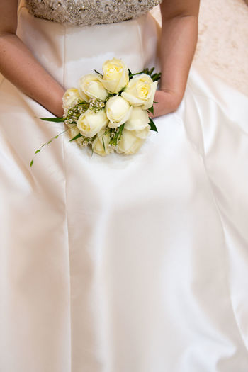 Flowering Plant Flower Wedding Bride Newlywed Bouquet Flower Arrangement Celebration Wedding Dress Midsection Women Plant One Person Adult Life Events Event Holding White Color Human Body Part Freshness Hand Wedding Ceremony Flower Head