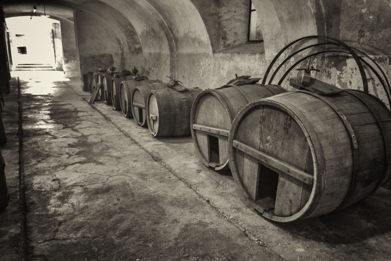 wine cask, wine cellar, winery, barrel, cellar, in a row, winemaking, wine, indoors, arch, food and drink industry, no people, alcohol, day