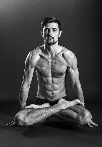 Lotus asana Black & White Yoga Adults Only Asana Black And White Blackandwhite Front View Full Length Handsome Indoors  Looking At Camera Men Muscular Build One Man Only One Person One Young Man Only Only Men People Portrait Shirtless Sportsman Strength Studio Shot Young Adult Young Men Be. Ready. AI Now