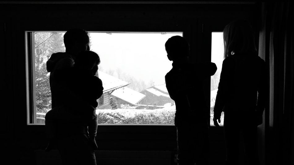 Window Indoors  Teamwork Standing Day People Adult Togetherness Father And Kids Standing Snow Anticipation Adult Father And Children Fatherhood Moments Family Love Black & White Dramatic Sky Family Time Father Waiting Swiss Mountains Weather Kids
