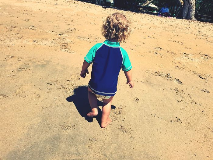 Sand Beach Full Length Childhood One Person Rear View Casual Clothing Sunlight Day Child Outdoors Real People Children Only Nature People One Boy Only Sky Fundayout Perfectweather Curls ♡