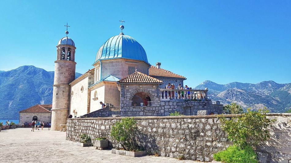 Montenegro PERAST Our Lady Of The Rocks Vacations Summer Seascape Seaview Blue Clear Sky Relaxation Place Of Worship Dome Travel Destinations Religion Architecture Outdoors Sky Day Building Exterior Church Steeple History Architecture Holiday