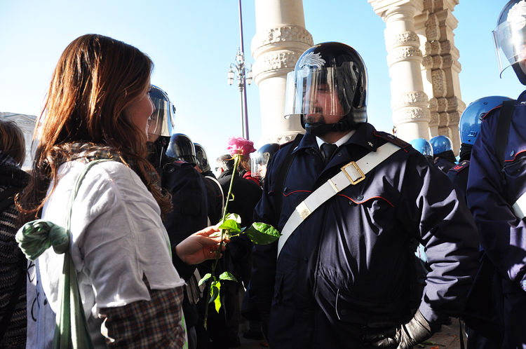 no violence: a girl gives a rose to a cop Girl No Violence Piazza Unità Police Force Rose - Flower Student Protest Trieste The Week On Eyem Resist The Photojournalist - 2018 EyeEm Awards