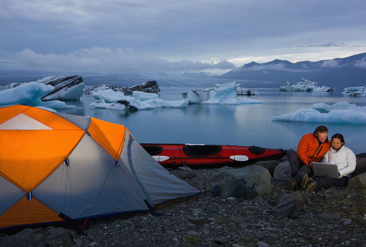 Scenic view of tent on snow covered mountain against sky