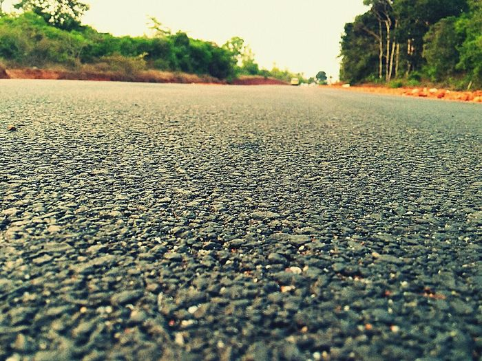 A Recently Constructed Asphalt Road Cutting Through the Dense Vegetation Atop The Hills ......
