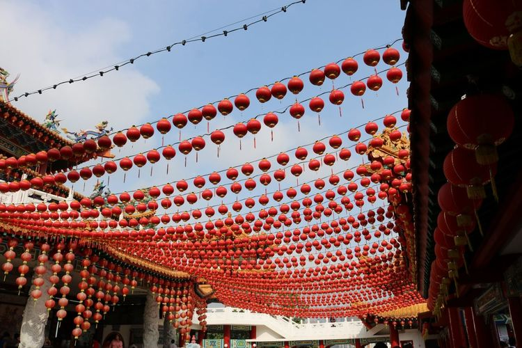 Low angle view of lanterns against sky