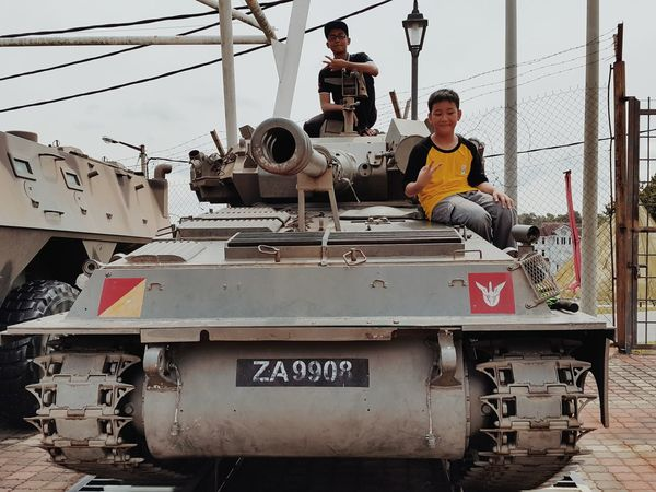Boys on army tank. Occupation People Welder Metal Industry Standing Boys Will Be Boys Young Men Childhood Friends Childhood Joy Childhood Fun Army Truck Army Tank Army Camp Army Vehicles Young Boys Adults Only Only Men Workshop Childhood Moments EyeEmNewHere Working Adult Military Vehicles Military Vehicle Military Zone