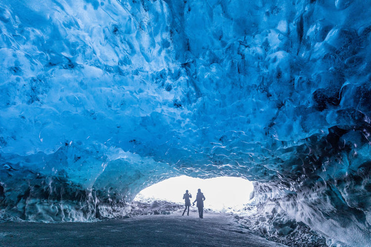 Tourists entering the ice cave at Vatnajokull in South East Iceland. Blue Close-up Europe EyeEmNewHere Glacier Icecave Iceland National Park Nature Naturephotography Scenics Silhouette Tourist Attraction  Travel Destinations Winter