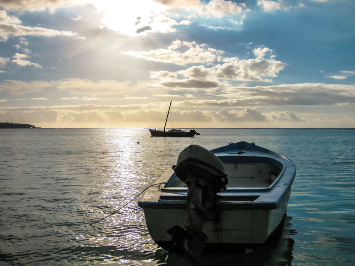 Boat at sunset in the calm waters of the small port of Trou aux Biches, Mauritius, Indian Ocean, Africa. Mauritius Mauritius Island  Island Africa Gris Gris Coast Gris Coast Ocean Sea Beach Fish Fishing Fishing Boat Nature Cliffs Seascape Fisherman Belle Mare Belle Mare Plage Plage Plage 🌴 Indian Ocean Trou Aux Biches Waterfront Water Sky Nautical Vessel Cloud - Sky Mode Of Transportation Transportation Scenics - Nature Horizon Sunset Beauty In Nature Horizon Over Water Tranquil Scene Tranquility No People Reflection Moored Idyllic Rowboat