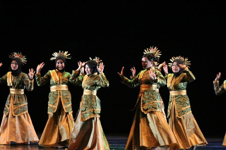 Women Wearing Costumes Dancing On Stage