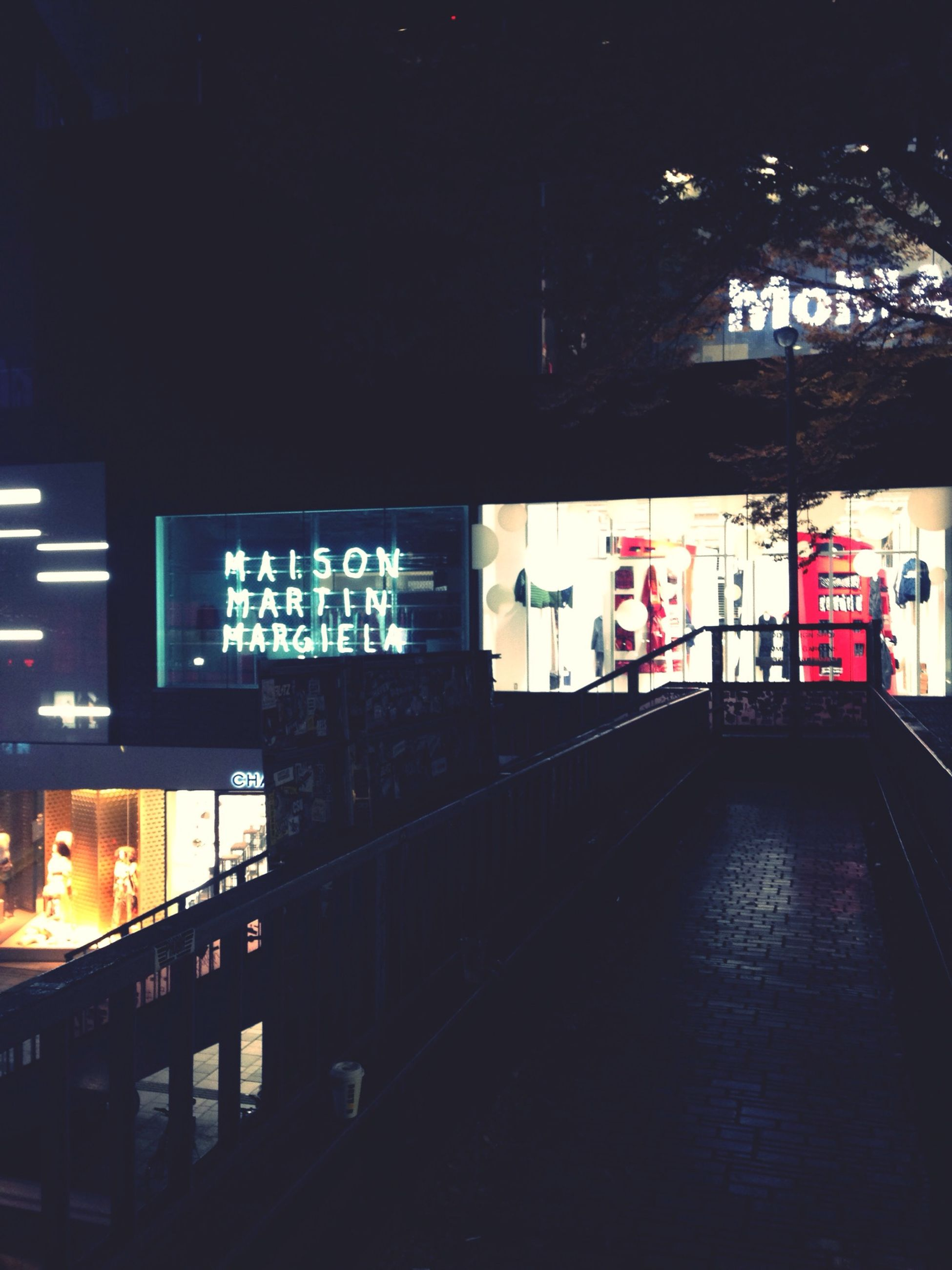 text, western script, communication, built structure, architecture, illuminated, non-western script, information sign, night, transportation, sign, information, capital letter, guidance, arrow symbol, city, building exterior, indoors, directional sign, no people