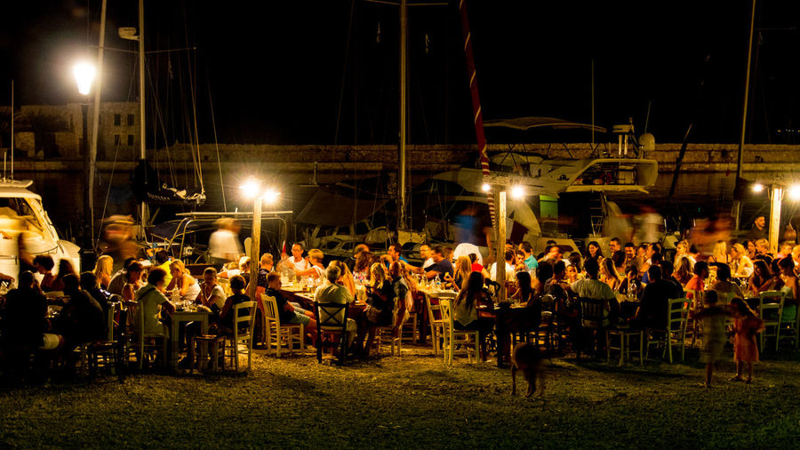 Restaurant at night at Chania Old Harbour, Crete Chania Old Port Food And Drink Marina Illuminated Large Group Of People Night Nightlife Restaurant
