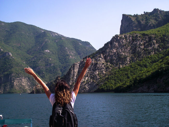 One Woman Only Arms Raised Mountains And Lakes Visiting Summer Views Water Young Women Women Mountain Adventure Arms Raised Sky Hiker Lakeside Lake Arms Outstretched Calm Standing Water Countryside Lakeshore