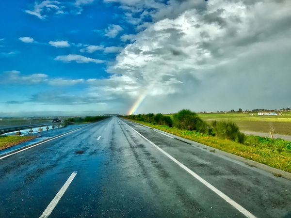 Rain, sun and rainbow near Kenitra in Morocco. Beauty In Nature Bushes Clouds Day Grass Ken Landscape Morocco Nature No People Outdoors Rain Rainbow Scenics Sky Street Sun The Way Forward Transportation