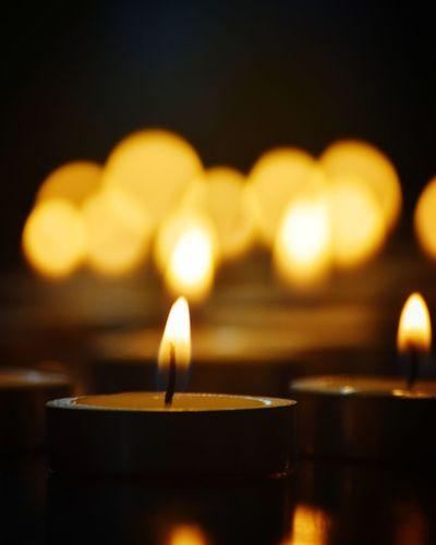 Close-up of illuminated light candles