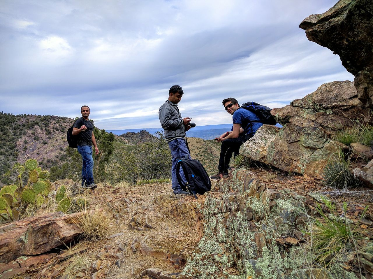 real people, nature, lifestyles, rock - object, cloud - sky, leisure activity, beauty in nature, full length, togetherness, mountain, day, sky, men, scenics, casual clothing, hiking, outdoors, standing, tranquility, adventure, friendship, landscape, women, people