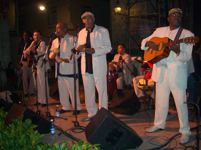 Cuban Musicians on New Years Eve Art Composition Costumes Cuba Cultures Full Frame Fun Happy Havana Illuminated In A Row Lifestyles Looking At Camera Making A Living Musicians New Years Eve Night Outdoor Photography Singing Stage Tourist Attraction  Tourist Destination White Suits