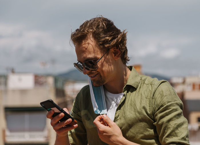 Low angle view of man using mobile phone