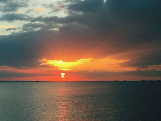 One of my favorite subject - Beautiful Sunset by Bay. IPhoneography Sunset Sea Scenics Sky Beauty In Nature Tranquil Scene Tranquility Nature Cloud - Sky Orange Color Water Dramatic Sky Sun No People Horizon Over Water Beach Day Outdoors Idyllic