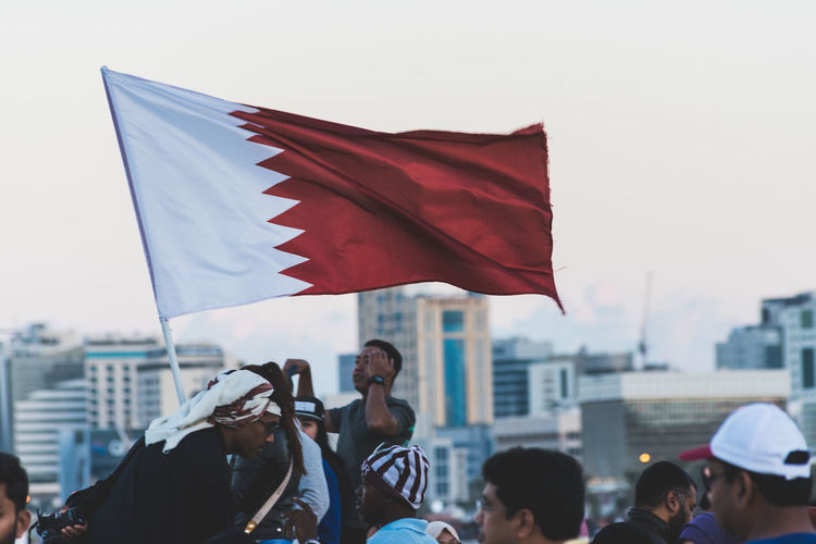 Doha Qatar National Day Architecture Building Exterior Built Structure City Crowd Day Democracy Flag Government Large Group Of People Men Outdoors Parade Patriotism Politics Pride Qatar Qatar Flag Real People Red Unity Waving Women