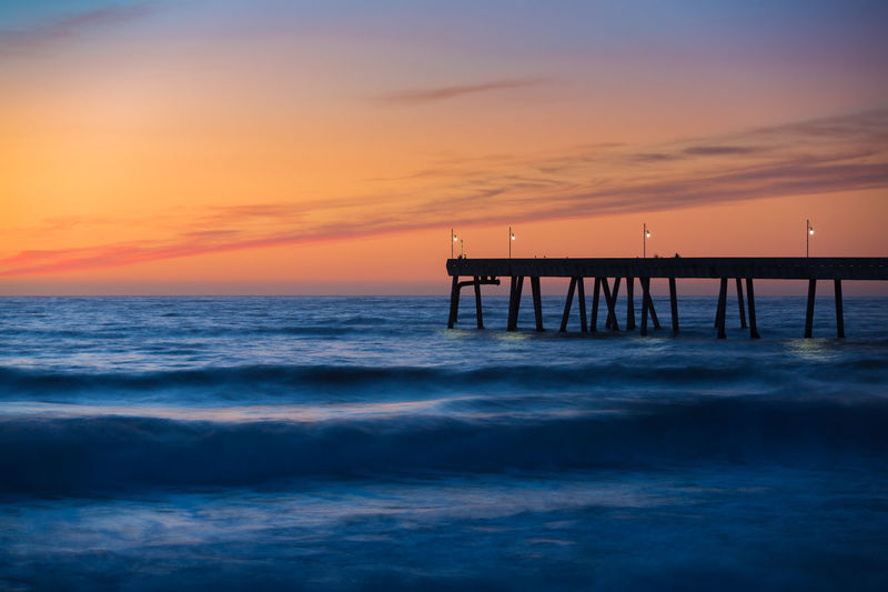 Sea Water Sky Sunset Horizon Beauty In Nature Scenics - Nature Pier Beach Outdoors No People Tranquility Horizon Over Water Orange Color Tranquil Scene Nature