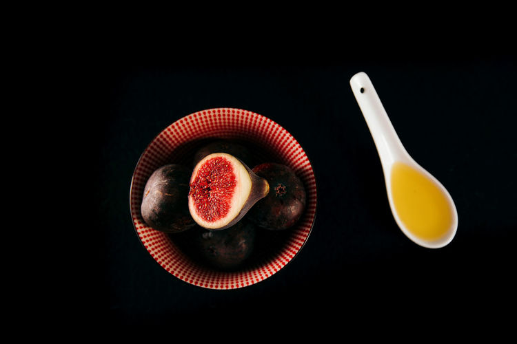 High angle view of fruits against black background