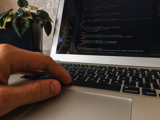 Close-up Code Computer Keyboard Computer Science Computer Screen Developer Focus In Foreground Freelance Geek Hand Hobbies Holding In The Office Indoors  Indoors  Internet IT Laptop People At Work Php Programming Touchpad Typing Work In Progress Work Space