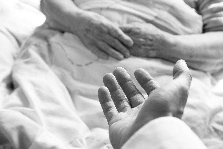 Giving a hand to an old woman laying in a bed Bed Bonding Care Childhood Close-up Day EyeEm Best Shots Fragility Grandmother Hospital Human Body Part Human Foot Human Hand Illness Indoors  Love Old People Real People Togetherness Two People Wrinkled TCPM