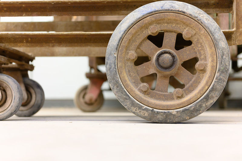 Close-up of metal wheel against blurred background