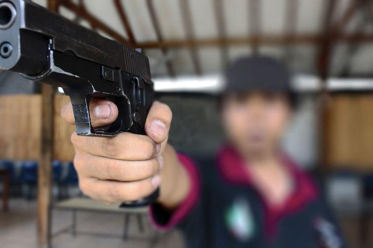 Man Practicing Target Shooting