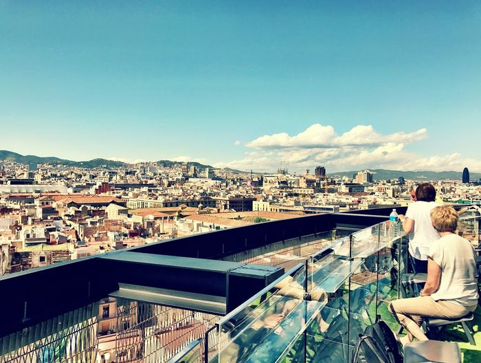 Raval Barcelona Architecture Built Structure Building Exterior City Crowded Day Sky Real People Outdoors Cityscape Men Sitting One Person People Adult Rooftop Panorama Clear Sky Shotoniphone7