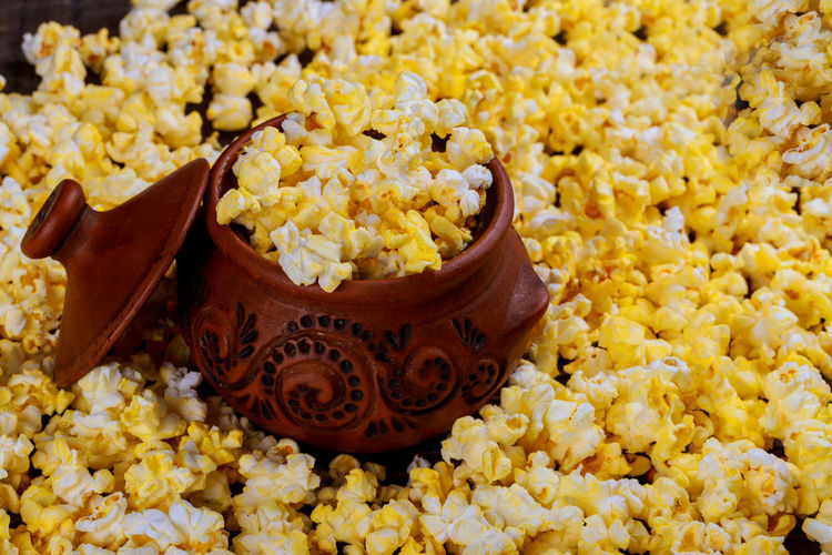 High angle view of popcorns with bowl on table