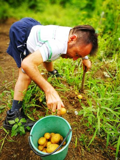 High angle view of mature man working at farm
