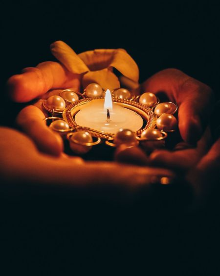 Human Hand Diya - Oil Lamp Diwali Oil Lamp Flame Celebration Burning Illuminated Candle Black Background Candlelight Wax First Eyeem Photo
