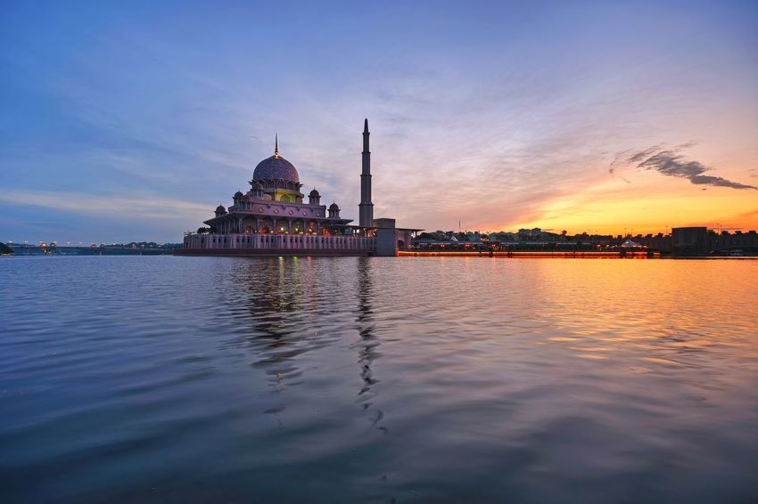 Beautiful Putrajaya mosque at sunrise Mosque Masjid Architecture Beautiful Lake Landscape Travel Destinations Outdoor Skyline Sunrise Sunset_collection Getty Images EyeEm Best Shots EyeEm Selects City Water Sunset Arts Culture And Entertainment Business Finance And Industry Beauty Reflection Blue Cityscape History Horizon Over Water Waterfront Scenics Tranquil Scene Tranquility Calm