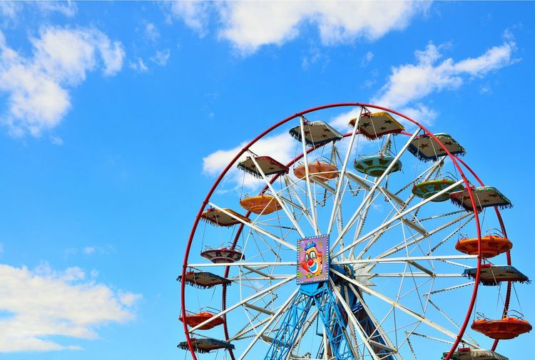 EyeEm Selects City Ferris Wheel Blue Arts Culture And Entertainment Amusement Park Amusement Park Ride Traveling Carnival Sky Cloud - Sky Tall - High Spire  Urban Skyline Cityscape