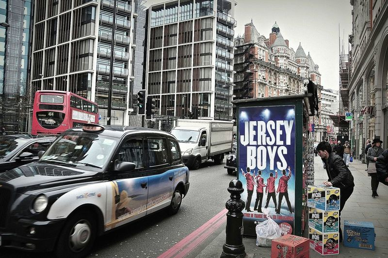 Jersey Boys , Car City City Street Day Jersey Boys Land Vehicle London London Lifestyle Londres Londresj'adore Newspaper Outdoors Street Street Life Street Photography Taxycab Embrace Urban Life Finding New Frontiers Live For The Story The Street Photographer - 2017 EyeEm Awards Postcode Postcards Postcode Postcards Mobility In Mega Cities Modern Workplace Culture Stories From The City
