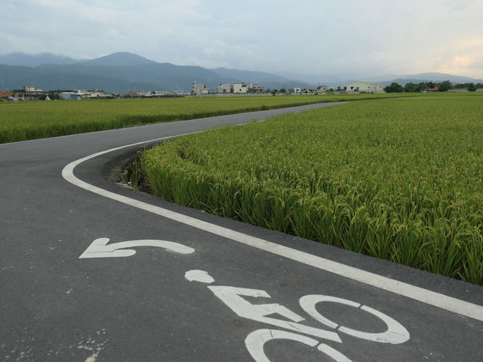 View of road passing through field