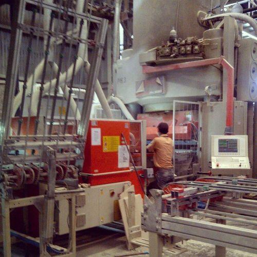 An operator infront of press machine. Operating. Operator Infront Pressing Press machine operating romanceramic roman ceramic operating daily task srki lyman balaraja tangerang banten indonesia