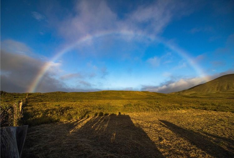 Roadside Rainbow Scenics Beauty In Nature Tranquil Scene Nature Landscape Sky Tranquility Idyllic Outdoors No People Non-urban Scene Mountain Day Beauty In Nature Travel Destinations Cloud - Sky Nature Travel Rainbow