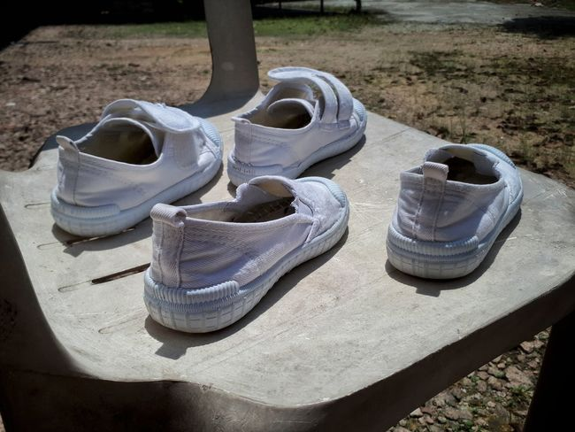 Day Outdoors School Shoes White Chair Under The Sun Day Light Dry Shoes School Holiday Weekend Activities