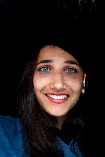 Head shot of a beautiful young woman with large black hat on head One Person Toothy Smile Looking At Camera Portrait Headshot Smiling Happiness Front View Close-up Beautiful Woman Human Face Female Face Hat Mixed Race Person Young Woman Woman Cheerful Lipstick Indian Ethnicity Beautiful Face  Tanned