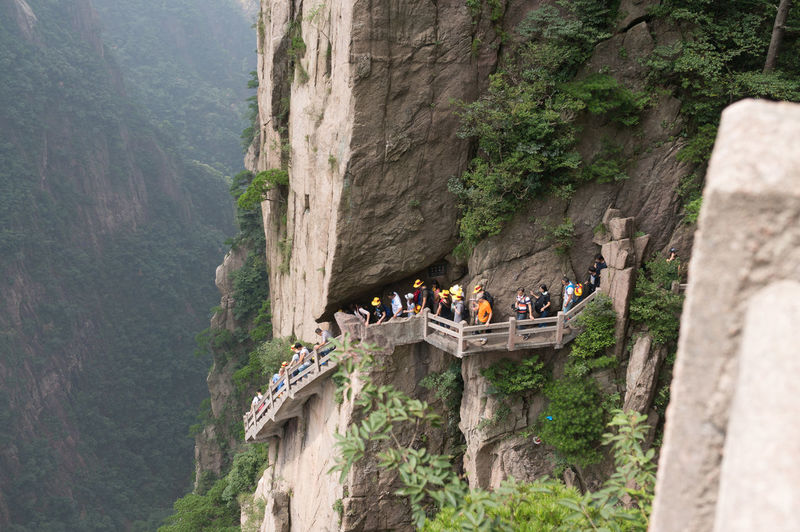 Tourists On Steps At Huangshan Mountain Cliff