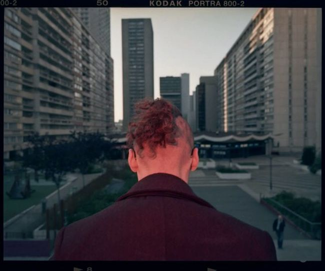 Rear view of man looking at city buildings