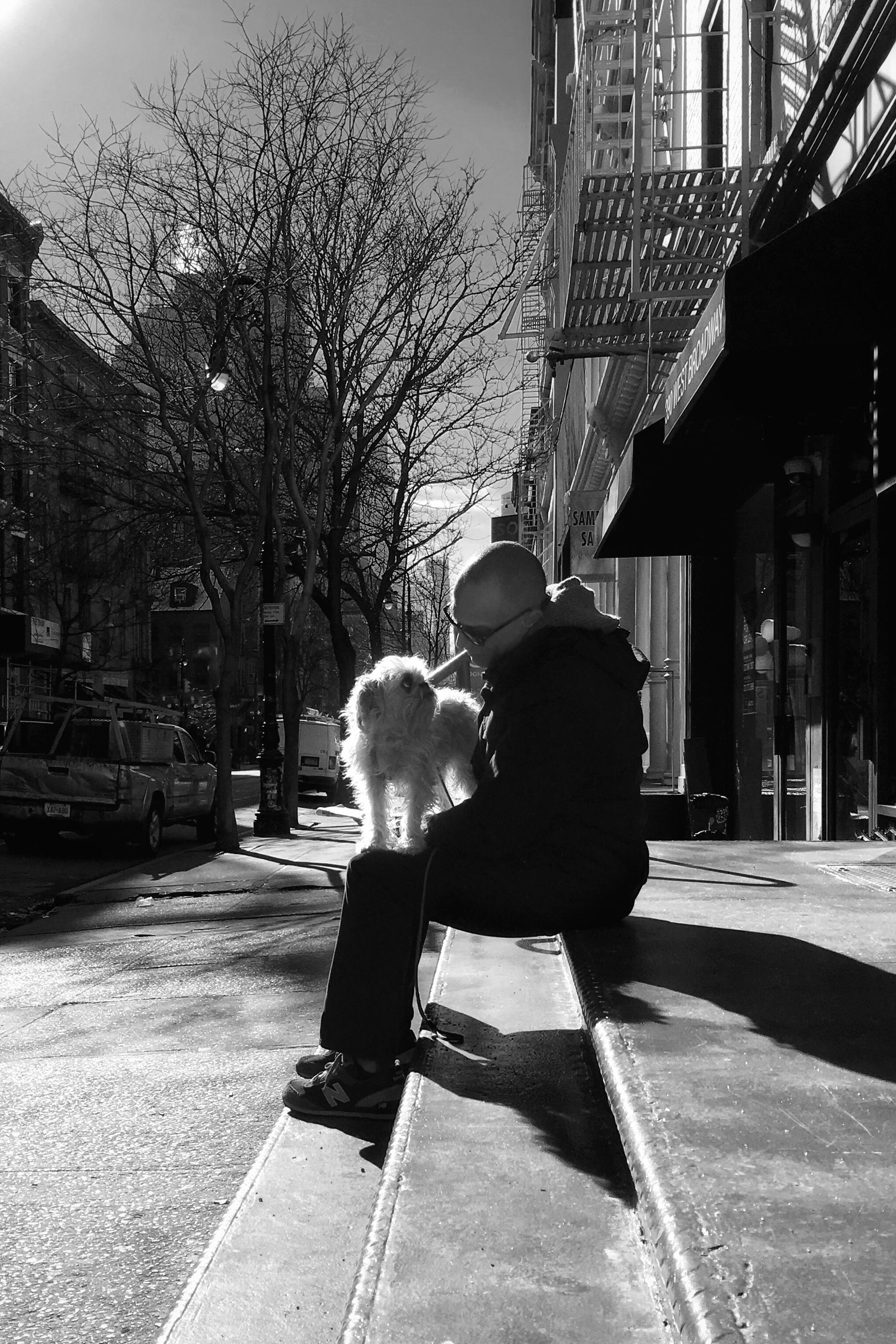 two people, togetherness, bonding, warm clothing, rear view, real people, outdoors, built structure, full length, leisure activity, building exterior, architecture, people, baby, women, happiness, childhood, sky, day, adult
