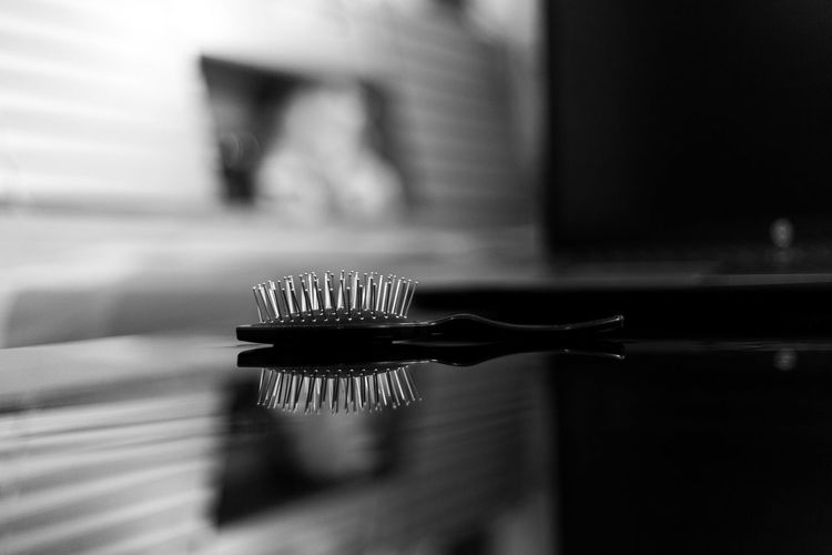Close-up of hairbrush on table at home